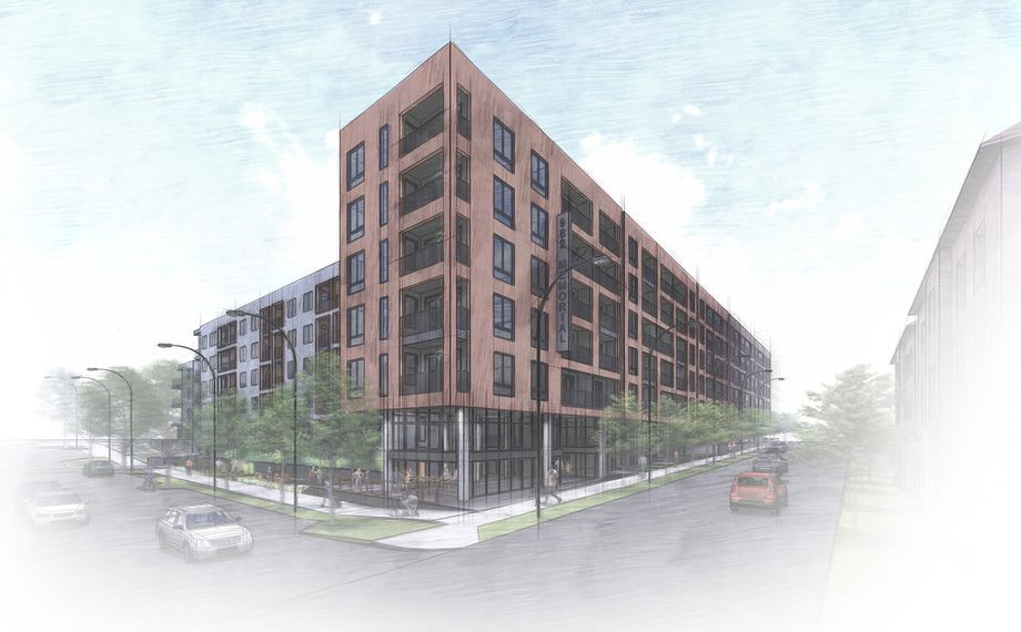 A rendering showing a large brick building that fronts a black road.