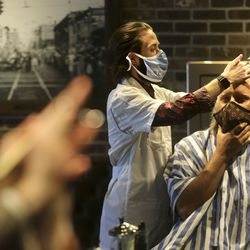 Ace Parkin, City Barbers manager, cuts Ed Cable's hair at City Barbers on Broadway between 200 East and 300 East in Salt Lake City on Thursday, June 18, 2020.