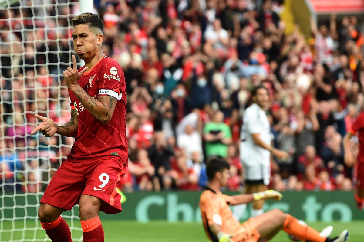 Roberto Firmino of Liverpool celebrates with finger guns after scoring the second goal at Anfield on August 09, 2021 in Liverpool, England.