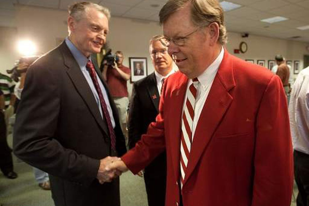 Regents Jim McClurg, right, and Tim Clare, center greet Nebraska Athletic Director Tom Osborne before the start of a Nebraksa Board of Regents meeting held to discuss and vote on a resolution for conference alignment.  KENT SIEVERS/THE WORLD-HERALD