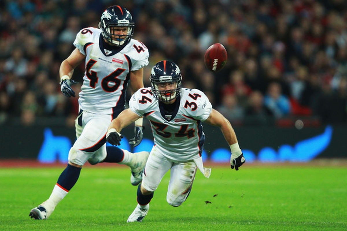 LONDON ENGLAND - OCTOBER 31: Spencer Larsen #46  and Kyle McCarthy #34 of Denver Broncos keep their eye on the ball during a game. (Photo by Warren Little/Getty Images)