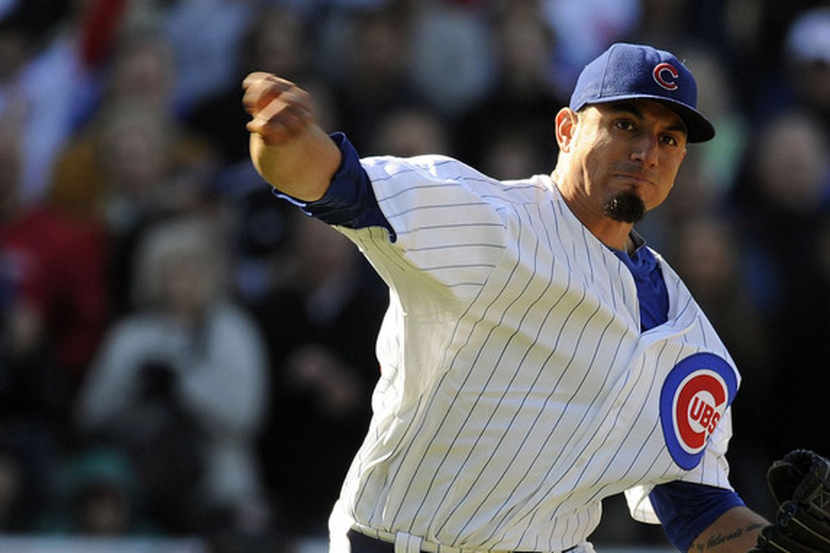 Chicago Cubs starting pitcher Matt Garza makes a throwing error in the ninth inning against the Milwaukee Brewers at Wrigley Field. The Cubs defeated the Brewers 8-0.  Credit: David Banks-US PRESSWIRE