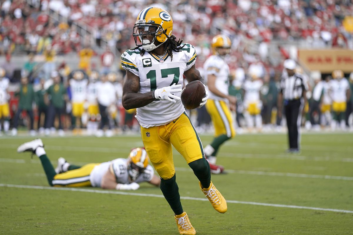 Davante Adams #17 of the Green Bay Packers runs for a touchdown after catching a pass during the first quarter against the San Francisco 49ers in the game at Levi's Stadium on September 26, 2021 in Santa Clara, California.