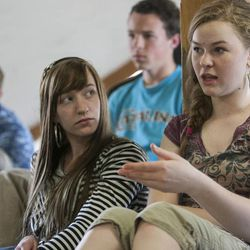 Sierra Brooksby listens to Alyssa Hokanson as she expresses an opinion. A group of home-schooled kids attend a debate class Friday, March 29, 2013, in Orem.