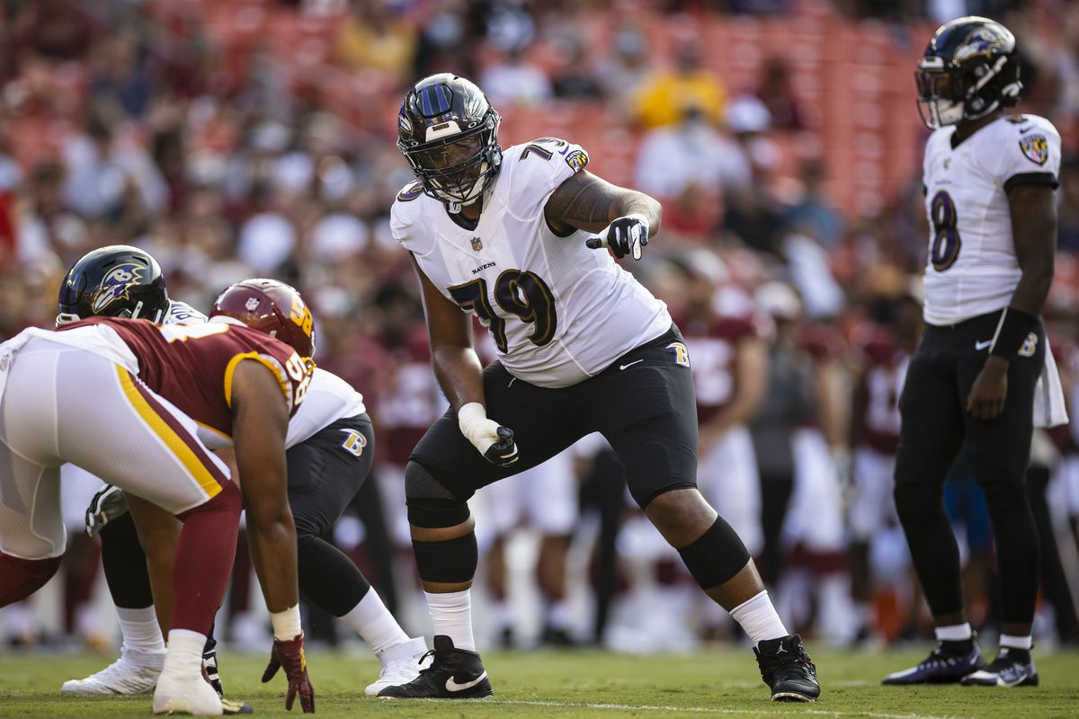 Ronnie Stanley #79 of the Baltimore Ravens lines up against the Washington Football Team during the first half of the preseason game at FedExField on August 28, 2021 in Landover, Maryland.