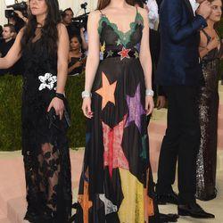Dakota Johnson wears a Gucci dress.