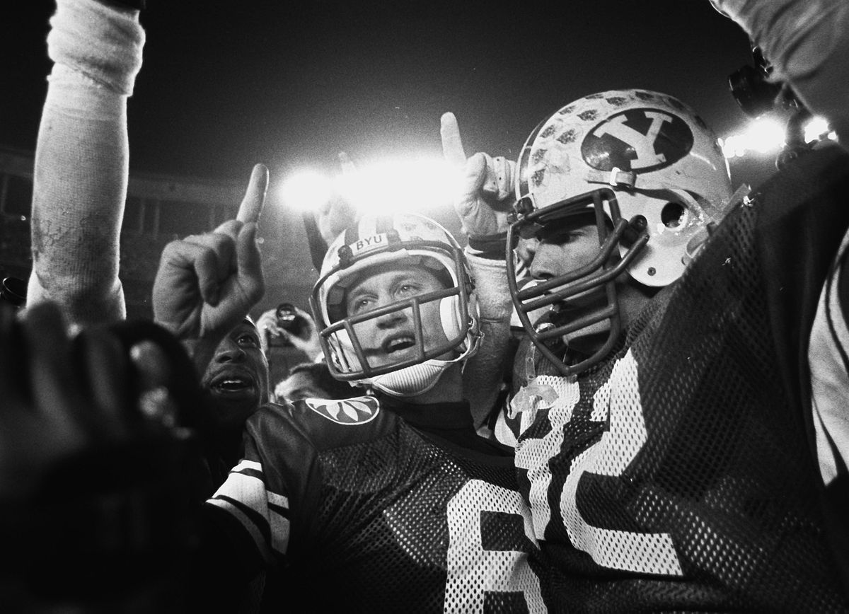 BYU quarterback Robbie Bosco celebrates with his team after winning the Holiday Bowl in San Diego on Dec. 21, 1984.
