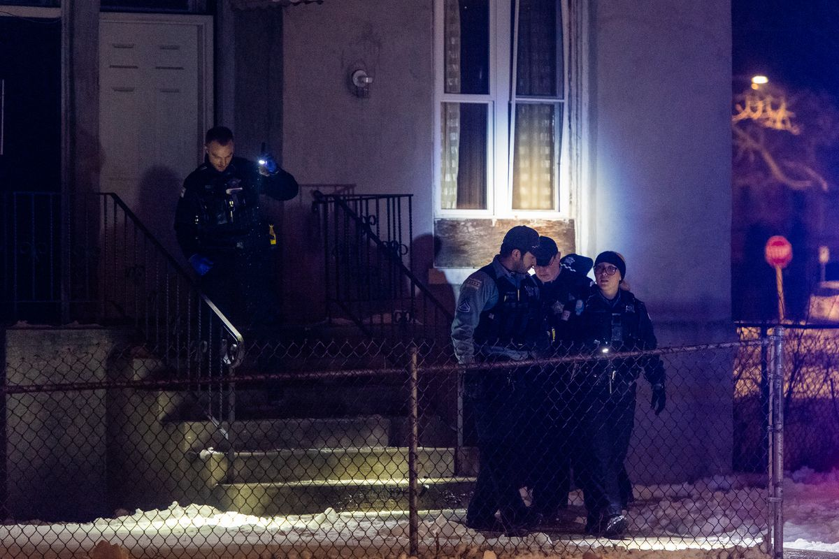 Police investigate the scene where a man says he was shot in his apartment, Tuesday morning, in the 6900 block of South Parnell, in the Englewood neighborhood.   Tyler LaRiviere/Sun-Times