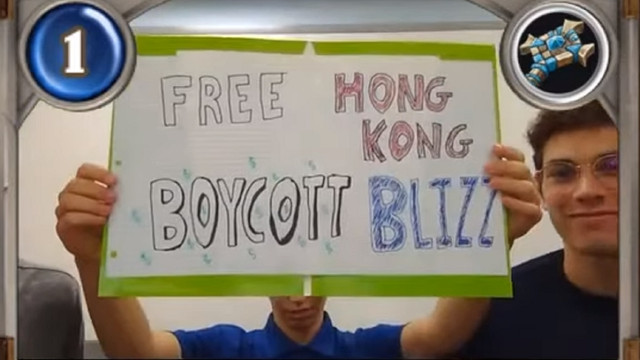 "American University Hearthstone players holding a sign that reads ""Free Hong Kong, Boycott Blizz"""