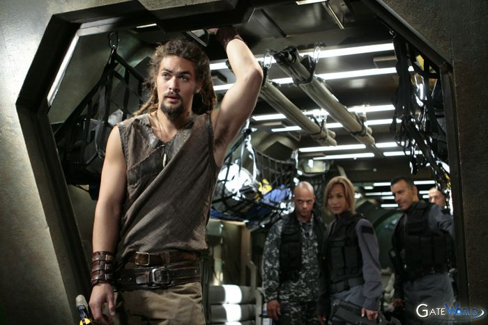 Ronon Dex, played by Jason Momoa, looks out a spaceship