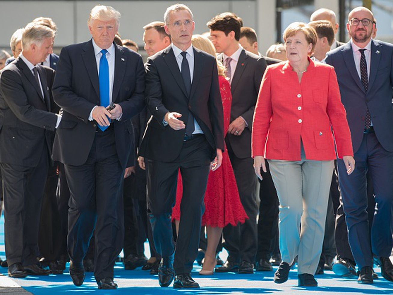 President Donald Trump, NATO Secretary General Jens Stoltenberg, Chancellor of Germany Angela Merkel, and Belgian Prime Minister Charles Michel arrive in May 2017 for the unveiling of NATO's new headquarters in Brussels.