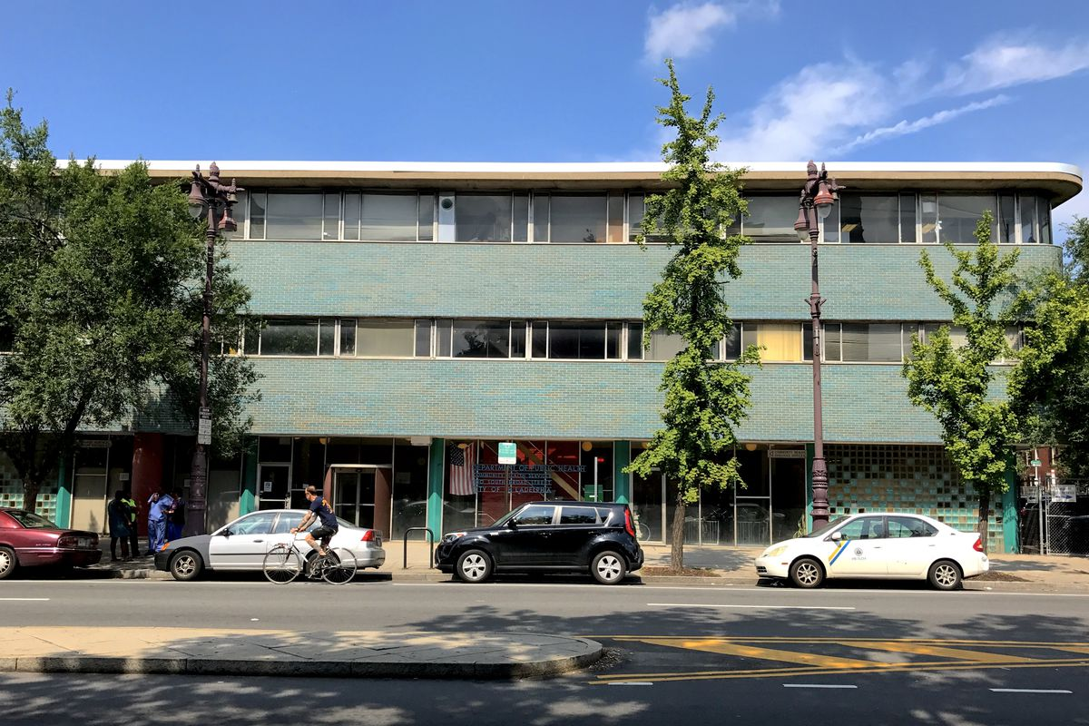 A teal-colored midcentury modern health center.