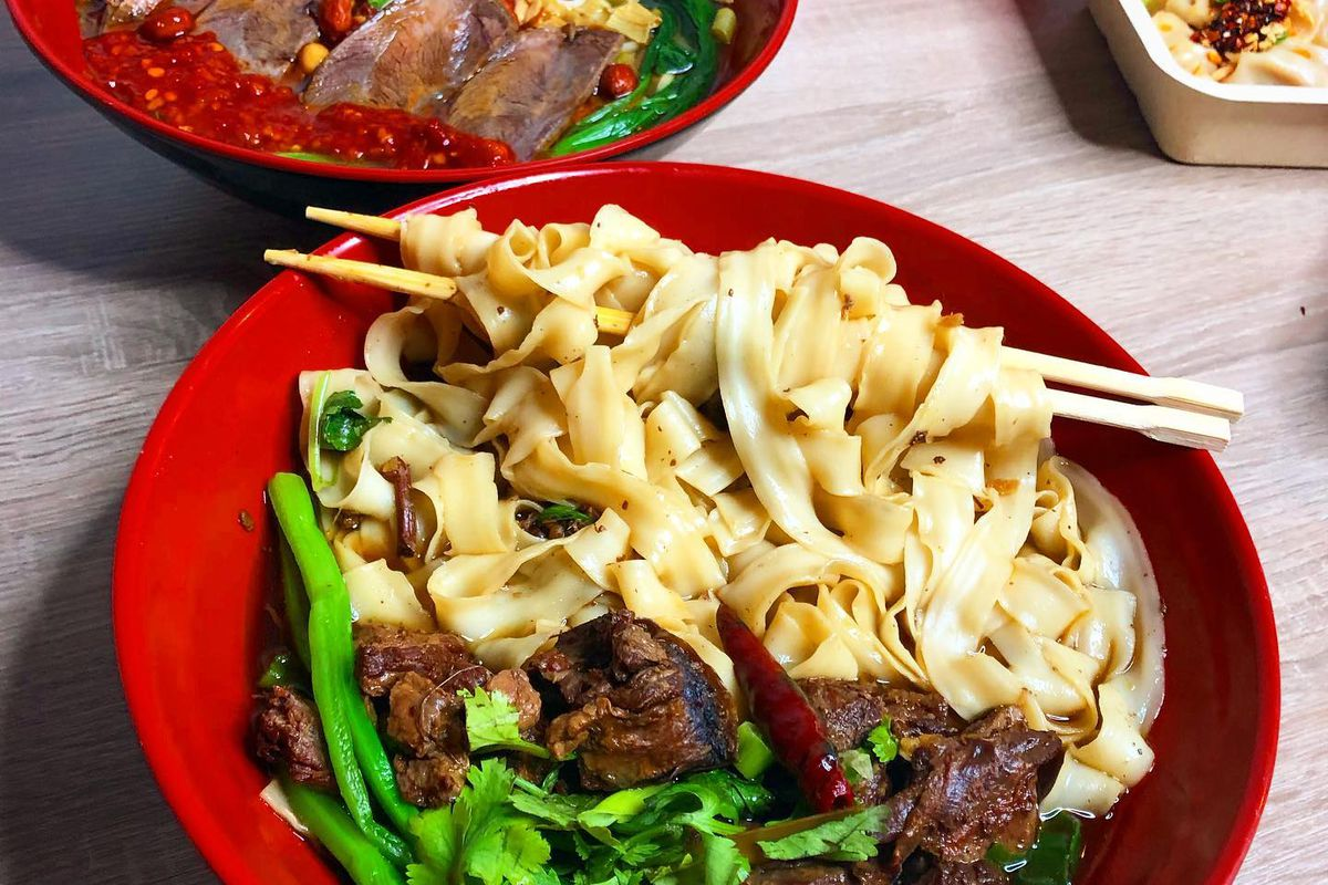 Two bowls of noodles soups from Qin West Noodle House
