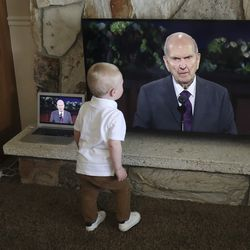 Hank Bengtzen and his family watch the Sunday morning session of the 190th Annual General Conference of The Church of Jesus Christ of Latter-day Saints at home in Millcreek on Sunday, April 5, 2020.