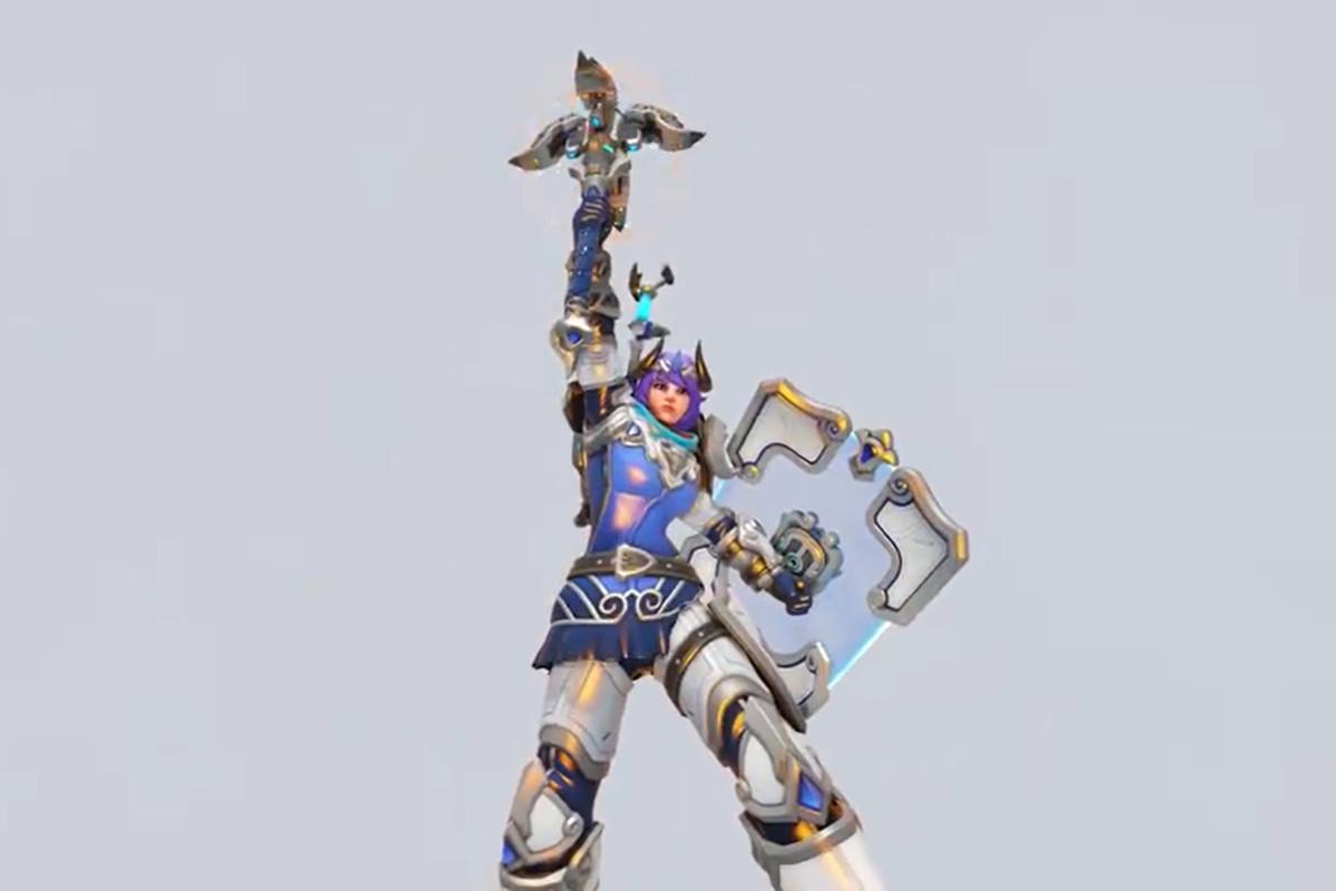 Overwatch hero Brigitte holding her hammer wearing a purple and white GOAT skin