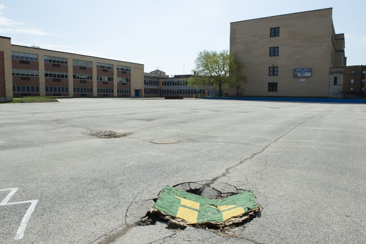 The asphalt play area that was turned into a play ground, garden and turf field at Arnold Mireles Elementary Academy in South Chicago.