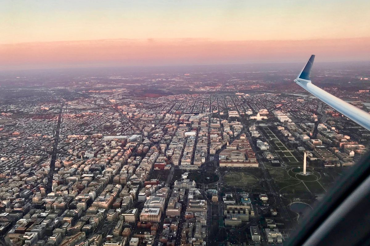Washington, D.C., as seen from a plane. The Washington Monument and the National Mall are viewable.
