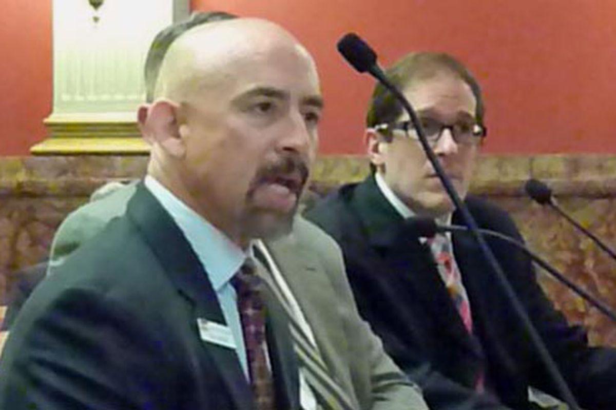 Lt. Gov. Joe Garcia makes points on higher education bill as sponsor Mark, Ferrandino, speaker of the House at right, listens.