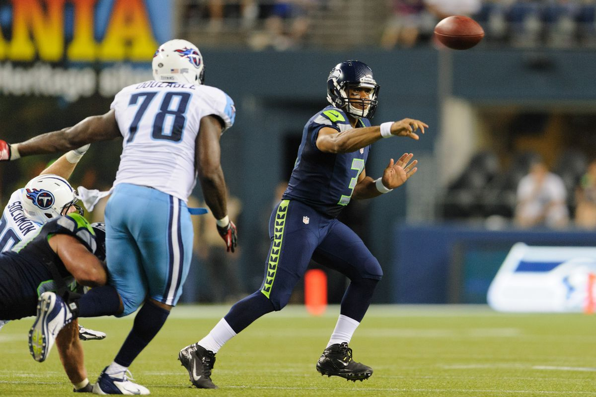 Aug 11, 2012; Seattle, WA, USA; Seattle Seahawks quarterback Russell Wilson (3) passes the ball during the 2nd half against the Tennessee Titans at CenturyLink Field. Seattle defeated Tennessee 27-17. Mandatory Credit: Steven Bisig-US PRESSWIRE