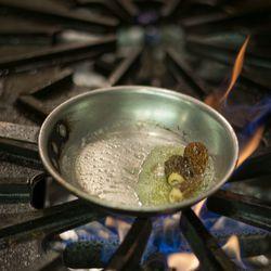 Sautéing morel mushrooms.
