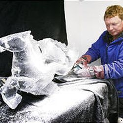 Ice Art sculptor Jeff DeJong works on an ice sculpture of a Sea Horse at his home in Salt Lake City.
