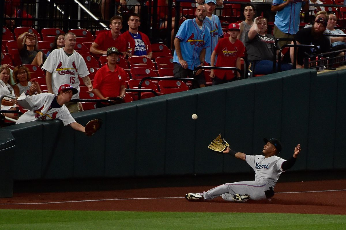 Miami Marlins second baseman Magneuris Sierra (34) slides but is unable to catch a ground rule double hit by St. Louis Cardinals right fielder Tommy Edman (not pictured) during the fifth inning at Busch Stadium