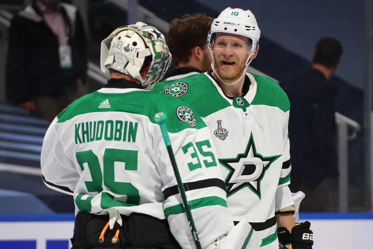 Goaltender Anton Khudobin #35 of the Dallas Stars is congratulated by Corey Perry #10 after their 4-1 win in Game One of the NHL Stanley Cup Final between the Dallas Stars and the Tampa Bay Lightning at Rogers Place on September 19, 2020 in Edmonton, Alberta, Canada.