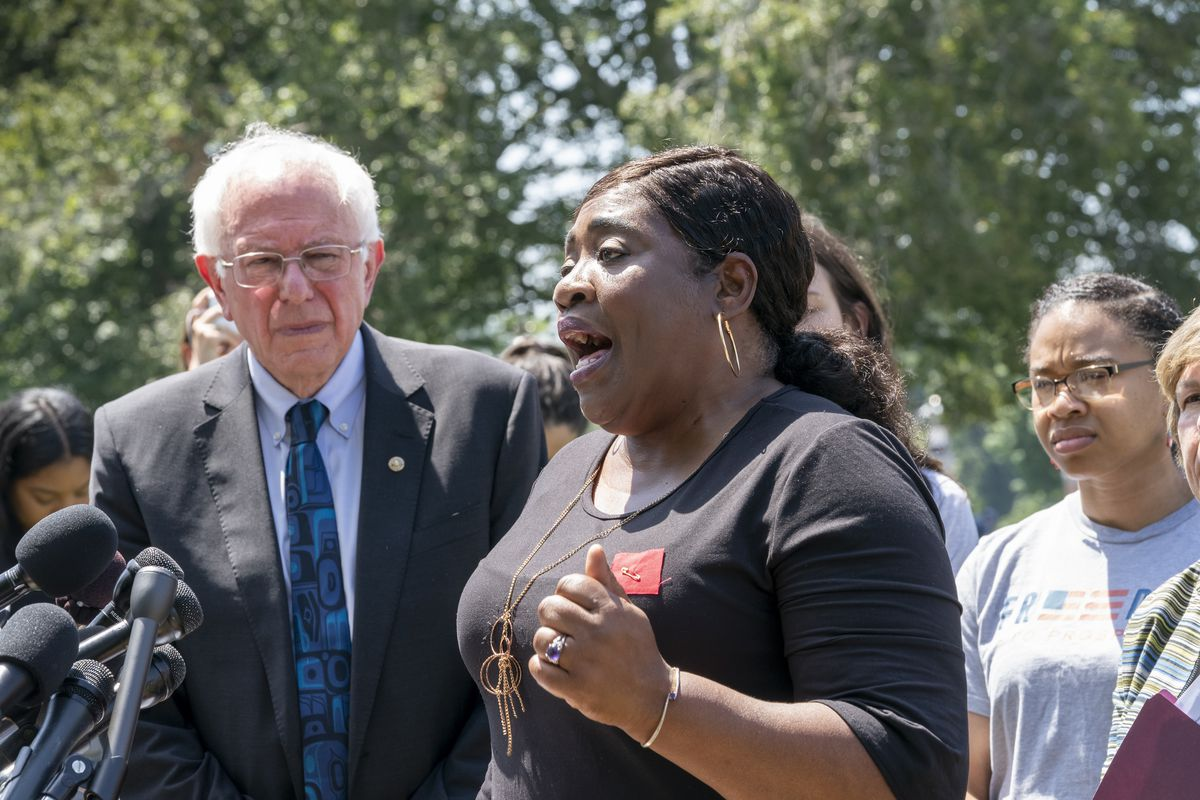 Democratic presidential candidate, Sen. Bernie Sanders (left) listens to a plea from Pamela Hunt, a mother with student loans, as he calls for legislation to cancel all student debt.