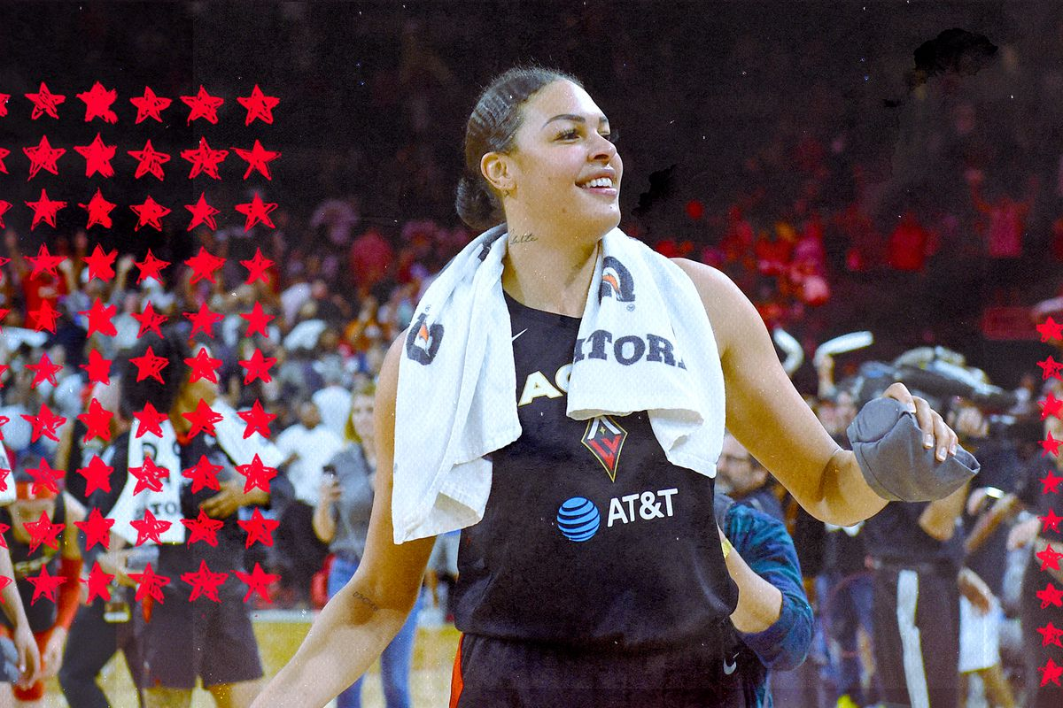 Liz Cambage smiles and walks off the court after a game.