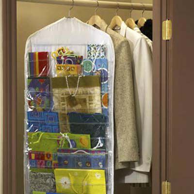 A hanging organizer in a closest with sections for different sizes and types of wrapping paper.