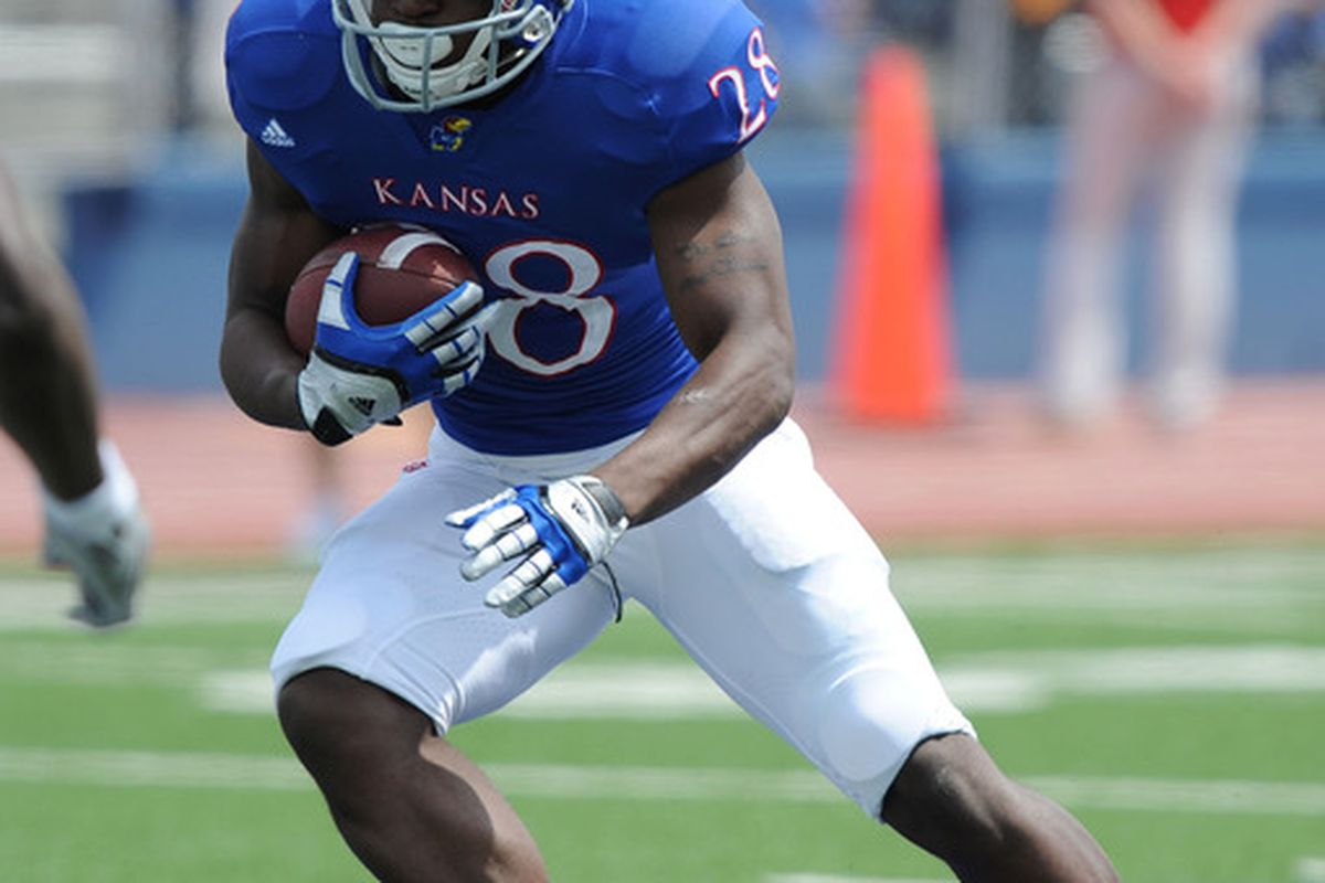 Apr 28, 2012; Lawrence, KS, USA; Kansas Jayhawks running back Marquis Jackson (28) carries the ball in the second half of the Spring Game at Memorial Stadium. Mandatory Credit: John Rieger-US PRESSWIRE