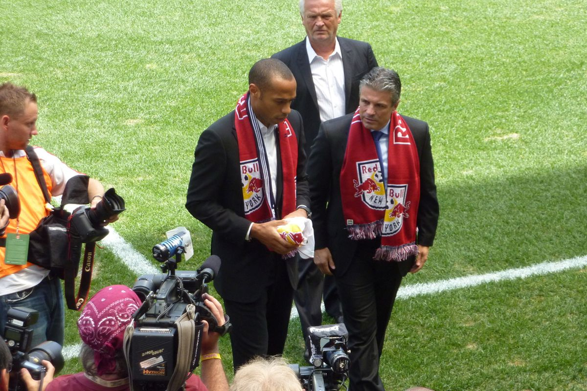 New York Red Bulls' Managing Director Erik Soler and newly-acquired Thierry Henry walk off the pitch at Red Bull Arena in Harrison, NJ Thursday, while Head Coach Hans Backe looks on. (photo by Howard Megdal)