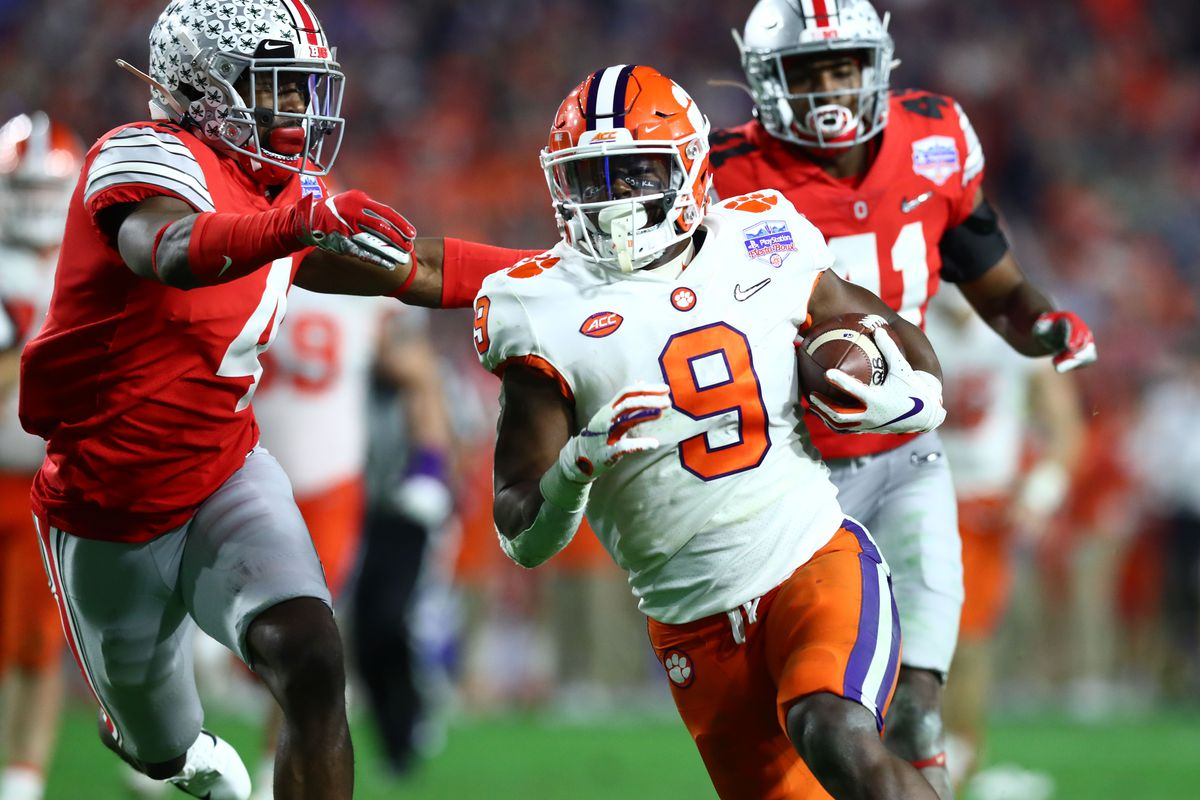 Clemson Tigers running back Travis Etienne scores a touchdown against the Ohio State Buckeyes during the fourth quarter in the 2019 Fiesta Bowl college football playoff semifinal game at State Farm Stadium.