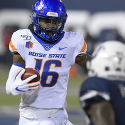 Boise State wide receiver John Hightower (16) runs on the way to a 30-yard touchdown reception as Utah State cornerback DJ Williams (7) defends during the first half of an NCAA college football game Saturday, Nov. 23, 2019, in Logan, Utah.