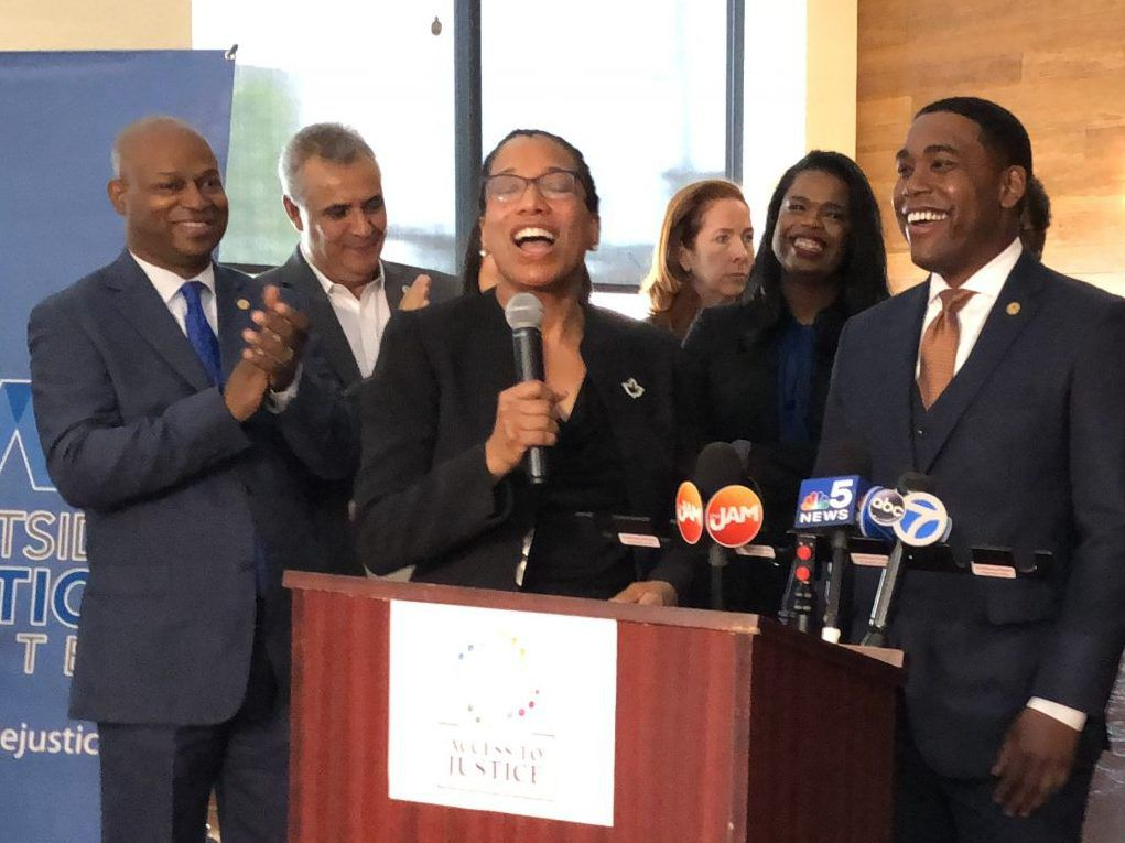 Tanya D. Woods, executive director of the Westside Justice Center in Lawndale, speaks at a press conference Monday to urge lawmakers to approve the Access to Justice Act, which would set aside $10 million to train staff to help poor residents across the s