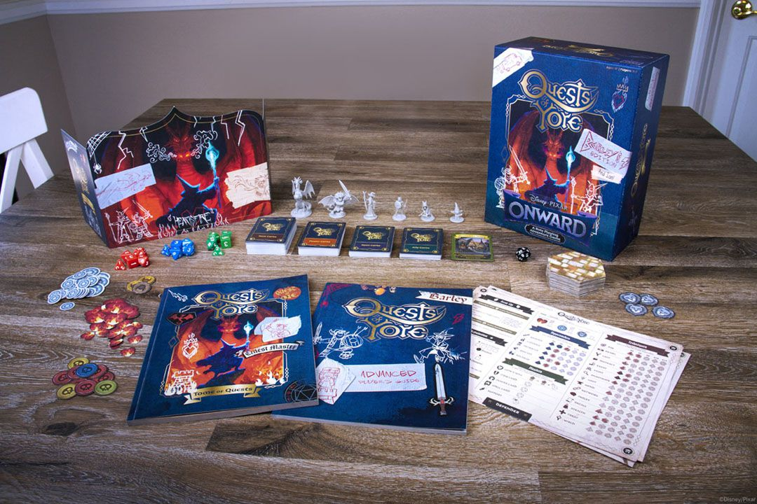 The components inside Quests of Yore all laid out for display. The game master's screen shows a wizard squaring off against a dragon, with doodles and faux masking tape holding it together.