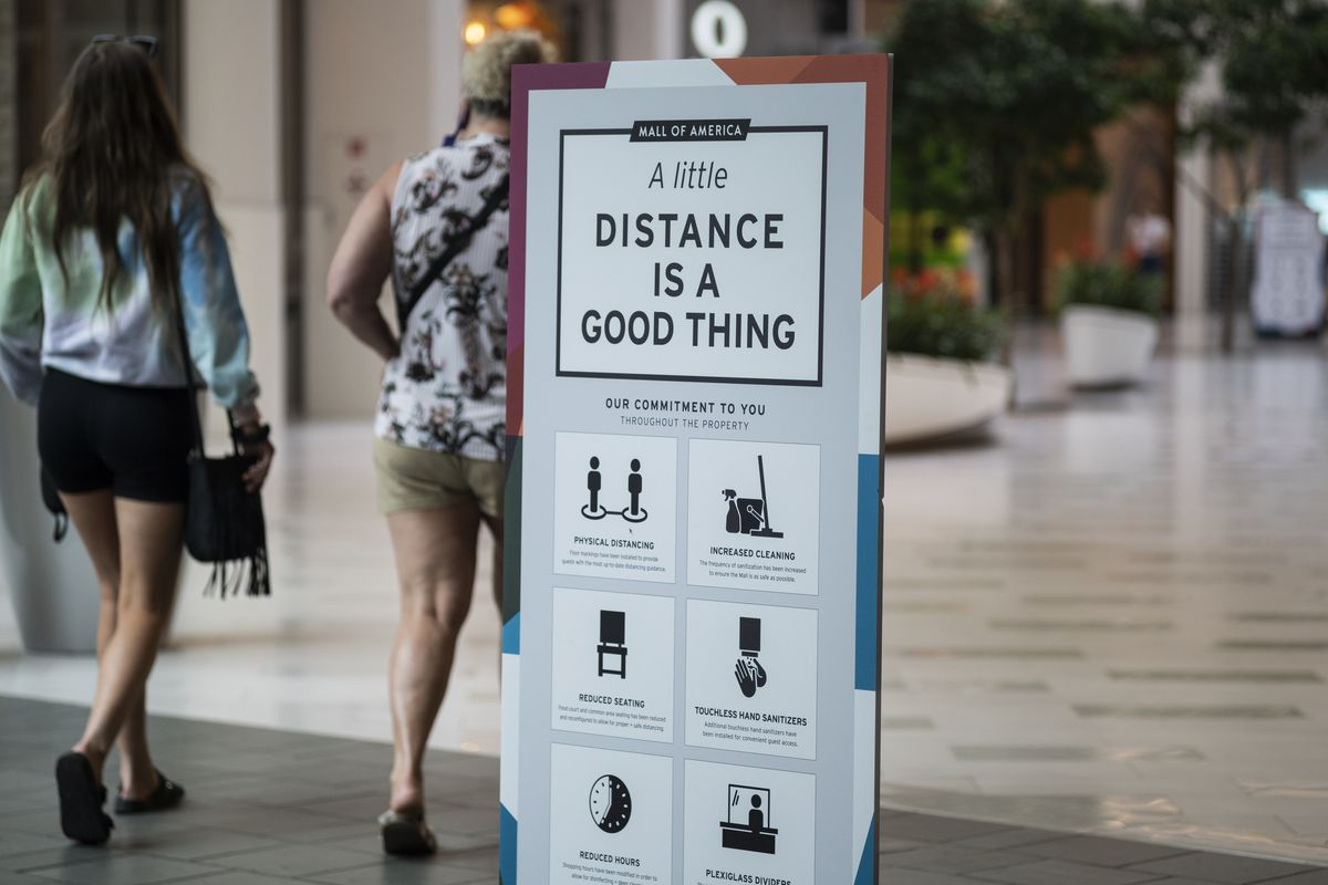 """New social distancing rules and procedures on display in the Mall of America say, """"Distance is a good thing."""""""