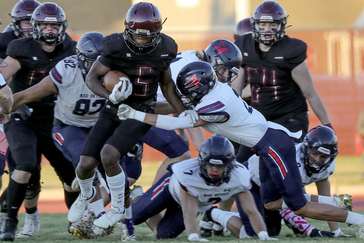 Maple Mountain's Thomas Weight gets tackled during the second round of the 5A football playoffs against Springville at Maple Mountain High School in Spanish Fork on Friday, Oct. 30, 2020. Maple Mountain won 27-21.