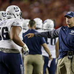 Utah State coach Matt Wells talks to his team during the second half of an NCAA college football game against Wisconsin on Friday, Sept. 1, 2017, in Madison, Wis.