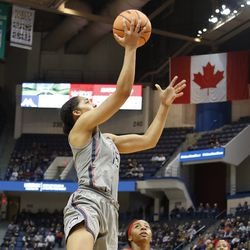 UConn�s Gabby Williams (15) takes it to the basket for two.
