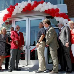 Spencer F. Eccles and Coach Kyle Whittingham cut the ribbon at the grand opening of the new Spence and Cleone Eccles Football Center at the University of Utah in Salt Lake City on Thursday, Aug. 15, 2013.