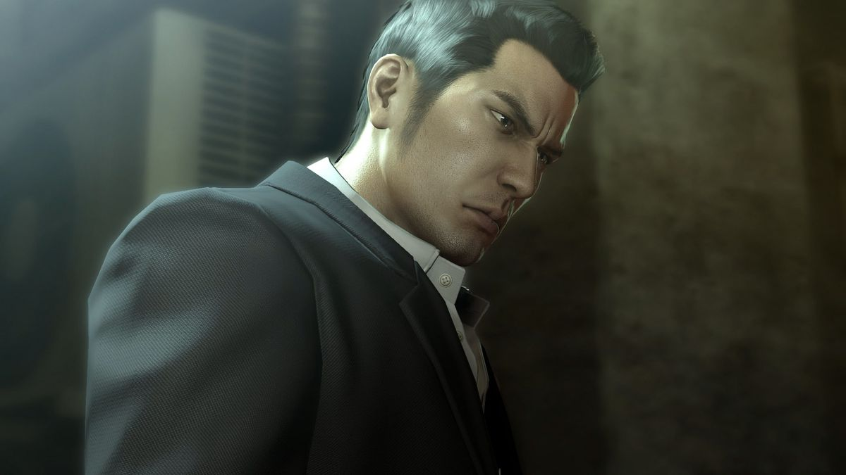This screenshot from Yakuza 0 features main character Kazuma Kiryu. He is dressed in a nice suit and white shirt, and his head is tilted down slightly, as though looking at someone on the ground in front of him.