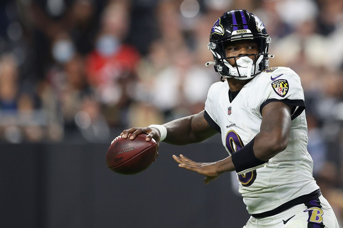Quarterback Lamar Jackson #8 of the Baltimore Ravens drops back to pass during the NFL game against the Las Vegas Raiders at Allegiant Stadium on September 13, 2021 in Las Vegas, Nevada.