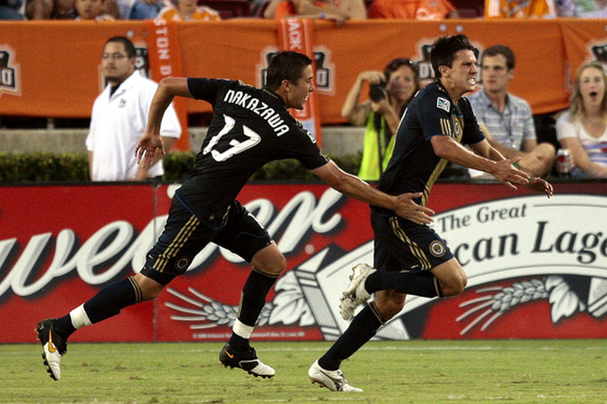 HOUSTON - MAY 29:  Shea Salinas, right of the Phildaelphia Union celebrates his first half goal with Kyle Nakazawa #13 against the Houston Dynamo at Robertson Stadium  on May 29, 2010 in Houston, Texas.  (Photo by Bob Levey/Getty Images)