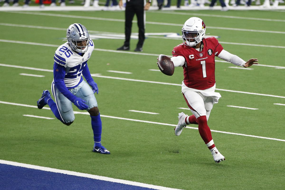 Arizona Cardinals quarterback Kyler Murray (1) runs for a touchdown against Dallas Cowboys free safety Xavier Woods (25) in the third quarter at AT&T Stadium
