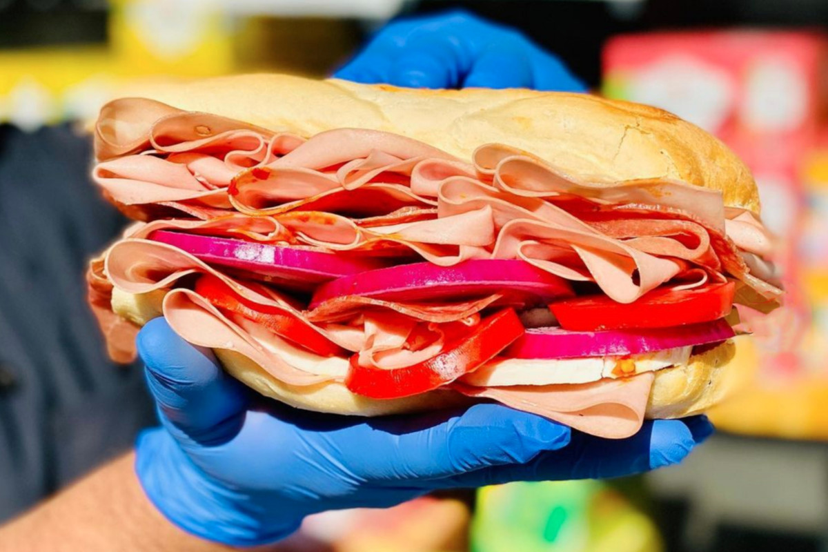 Man holding sandwich from Limoncello