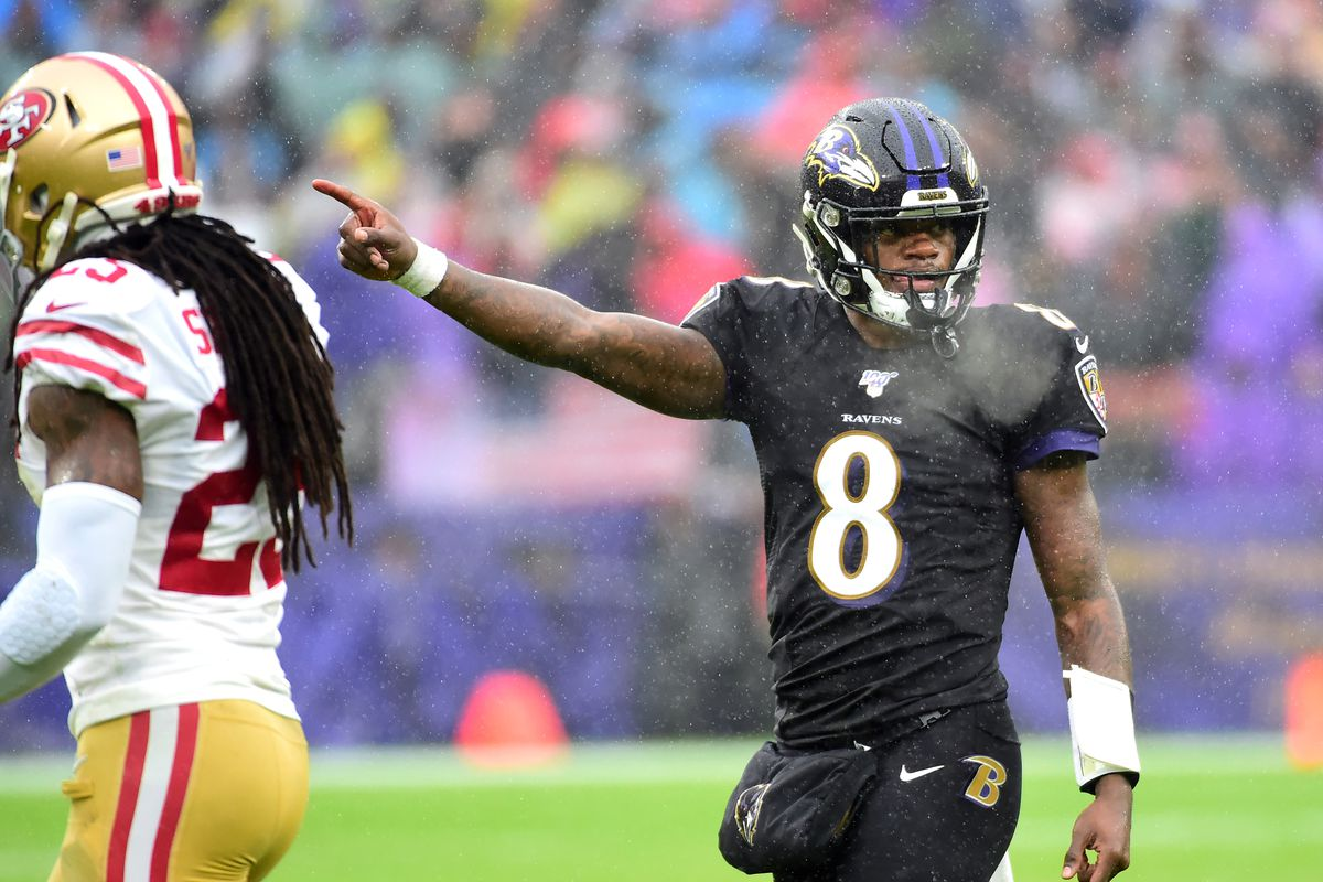 Baltimore Ravens quarterback Lamar Jackson indicates a first down in the second quarter against the San Francisco 49ers at M&T Bank Stadium.