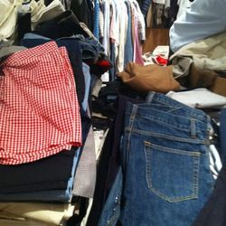 These men's shorts and trousers won't stay so neatly piled for long.....