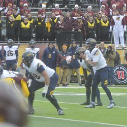 The CMU Marching Band reacts to the Toledo Rockets drive, as Carter Bradley calls for the snap.