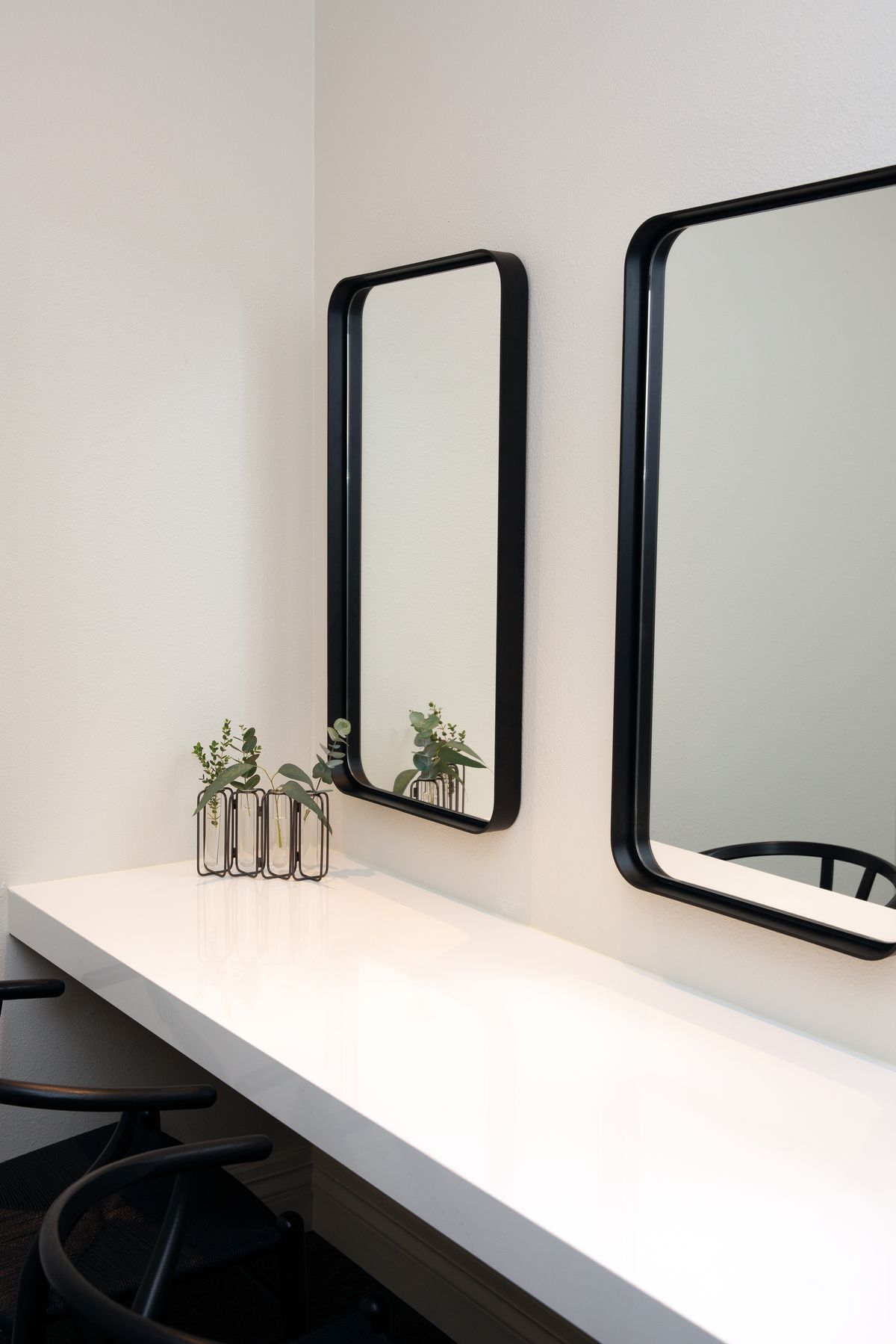 A counter with mirrors above.